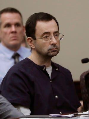 In this Jan. 24, 2018, file photo, former gymnastics doctor Larry Nassar sits during his sentencing hearing in Lansing, Michigan.