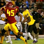 Hattiesburg running back Fabian Franklin carries the ball against Laurel Friday night during their game in Laurel.
