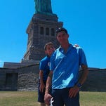 Long Valley resident Paul Eksteen and his son Keanu at the Statue of Liberty. Keanu, an American citizen, was taken to Paraguay by his mother Rosita Berdichevsky, a citizen of that country, on Nov. 2, against the wishes of his father, who is now fighting to get him back in the U.S.