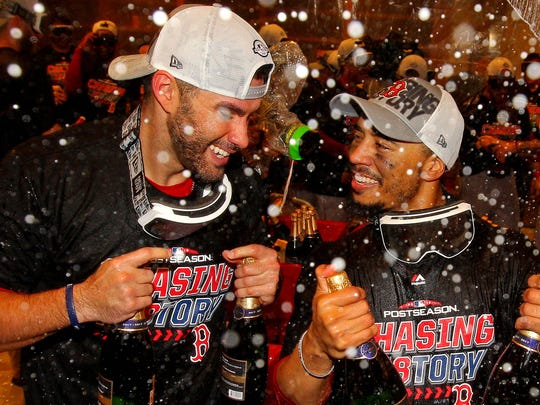 Red Sox designated hitter J.D. Martinez (28) and right fielder Mookie Betts (50) celebrate after beating the New York Yankees in Game 4 of the 2018 ALDS playoff series Oct 9.
