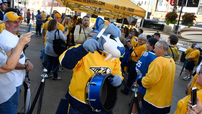 "Nashville Predators mascot ""Gnash,"" shown entertaining fans during an October game, will be the guest of the Pensacola Ice Flyers for their Predators theme night Friday at the Bay Center against Evansville."