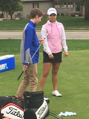 LPGA golfer Jenny Shin helps a young golfer  Thursday