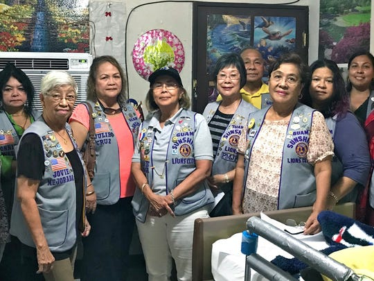 """Members of the Guam Sunshine Lions Club visited Ana Nauta, 81, at her residence in Pagachao, Agat, on Oct. 28 bringing supplies, song, and cheer as part of the club's ongoing service activities of """"Caring for the Sick and the Elderly."""" Pictured from left to right:  Lions Lou Jean Borja, Jill Pangelinan, Connie Rivera, Jovie Mejorada, Julie Cruz, Pres. Rosie Matsunaga, Marietta Camacho, Pete Babauta, Dee Cruz, Julie Garcia, Tish Tano, Lorraine Rivera, and Violet Borja."""