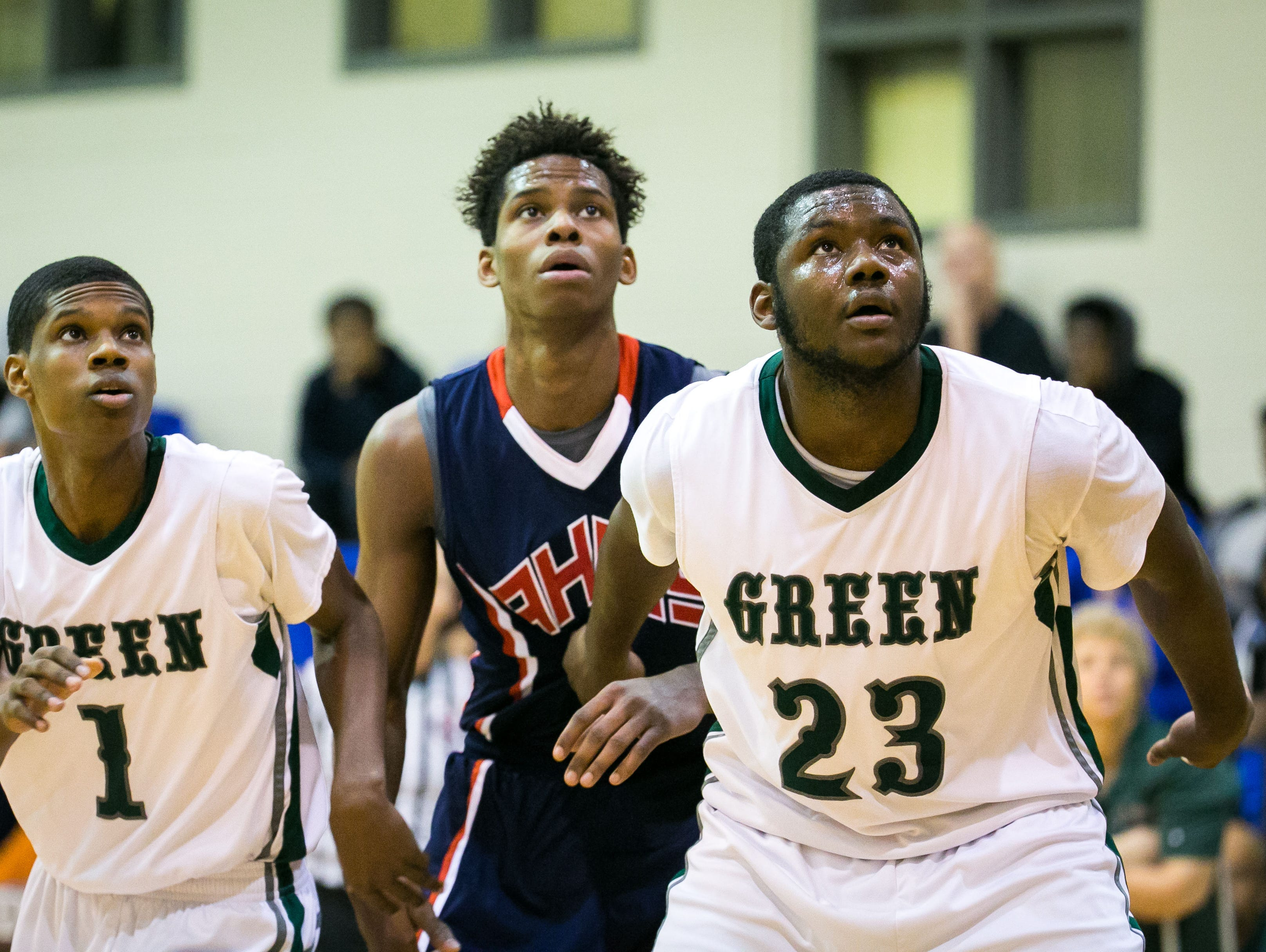 Ronald Shipman-Scott (right) of Mount Pleasant gets position for the rebound.