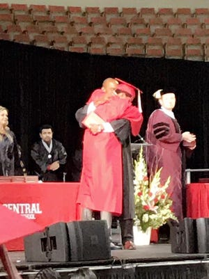 Anthony and his father embrace on stage at Central High School's graduation ceremony at the Veterans Memorial Coliseum on May 24, 2017.