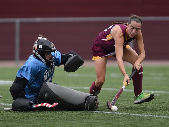 Salisbury's Becca Rinaca works against The College of New Jersey's Goal Keeper Kelly Schlupp on Saturday at Sea Gull Stadium.