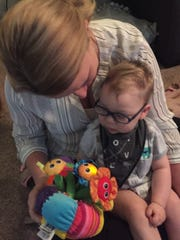 Lane Roffers plays with a toy borrowed from the Capable Kids program.
