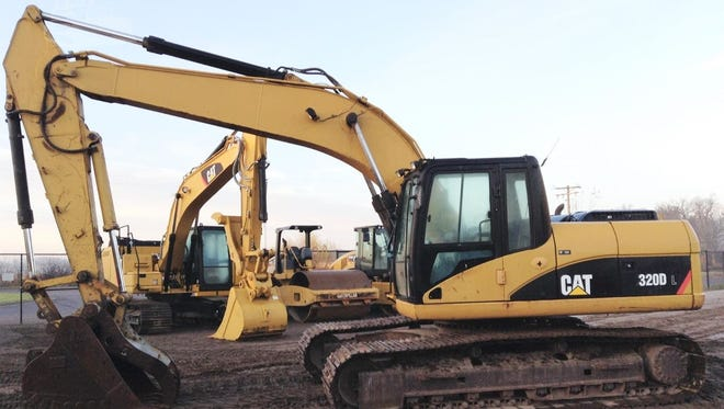 A Caterpillar 320DL excavator, similar to this one, was recovered after it was reported stolen from a ranch in Holliday. Rangers are still looking for the suspect in the crime.