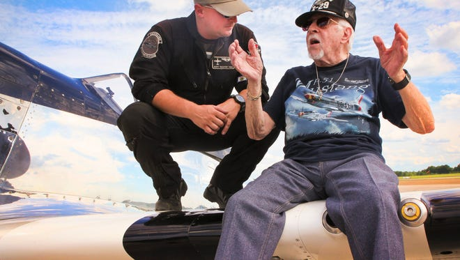 Air Force veteran Vincent 'Vinny' Pollizzotto tells P-51 Mustang pilot Scott 'Scooter' Yoak a tale from World War II.