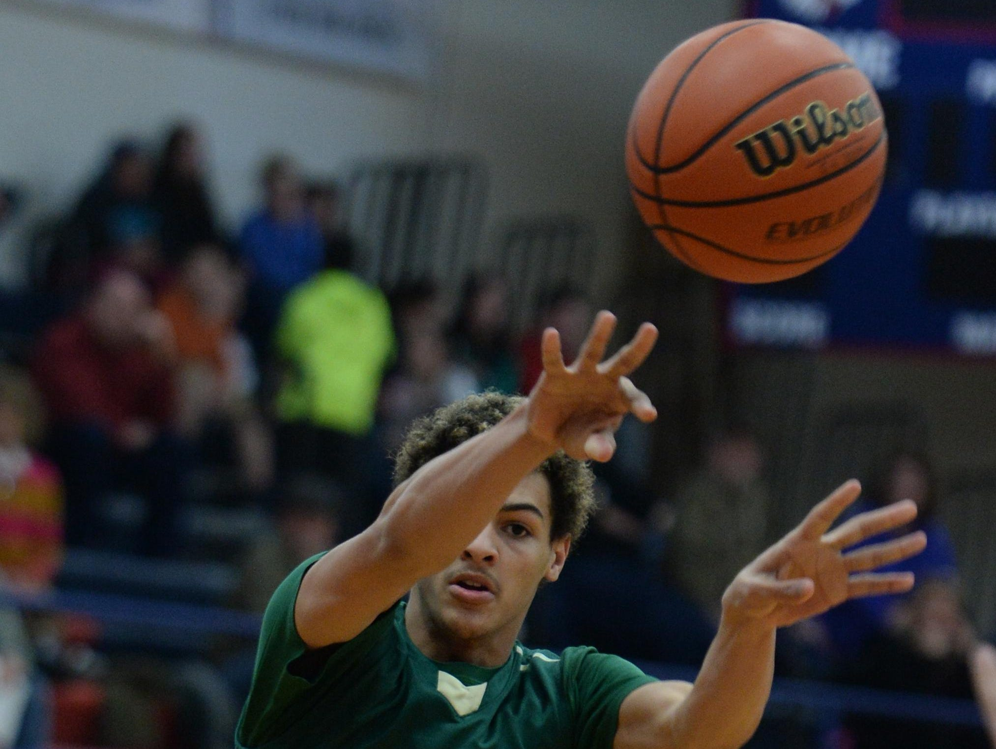 Northeastern's Tyler Smith passes the ball during a game in February. Smith picked up an offer from IUPUI on Tuesday.