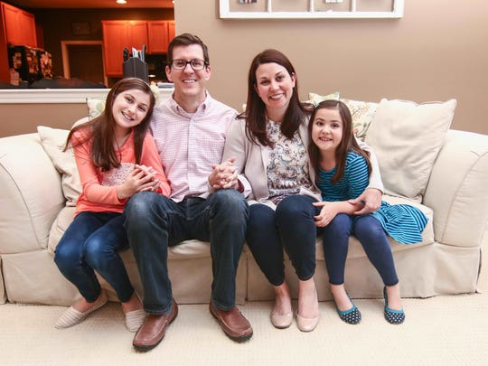 From left, Ann Stewart Wall, 10, Jason Wall, Michelle Wall and Ruby Wall, sit for a family photo at their home in Middletown on Friday, April 29, 2016,