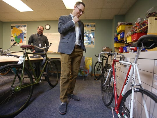 Nick Hoffman, chief curator at The History Museum at the Castle in Appleton, Wis.,  talks about a bicycle belonging to Wisconsinite Tom Schuler, who rode for the famed 1980s 7-Eleven racing team on Feb. 17, 2015 in Madison.  The bike will be on display in a new exhibit on bicycling in Wisconsin at the Wisconsin Historical Museum in Madison.  (AP Photo/Wisconsin State Journal, Amber Arnold)