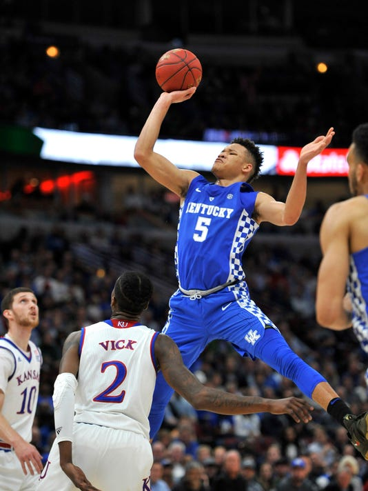 Kentucky forward Kevin Knox shoots over Kansas' Sviatoslav Mykhailiuk (10) and Lagerald Vick during the first half of an NCAA college basketball game Tuesday, Nov. 14, 2017, in Chicago. (AP Photo/Paul Beaty)