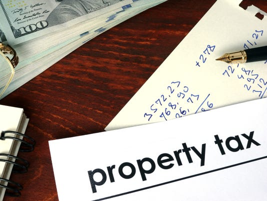 Property tax written on a paper. Financial concept.