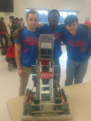 (From left) Matt Harris, Nyshawn Burton and Tristan Cossaboon, members of Millville High School's Engineering and Robotics team, were among the competitors on June 28 at the Burlington County Vocational School.