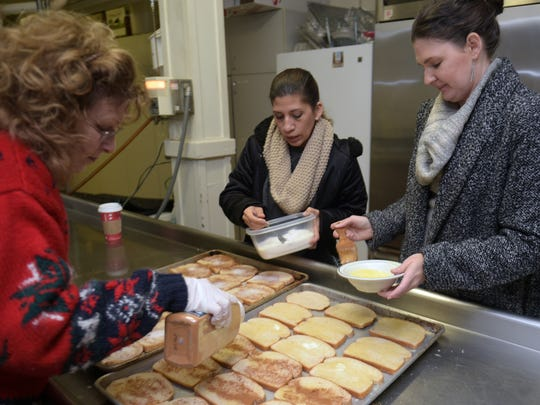 Robin Pace, left, Merari Swayn, center, of the Cookery and Lambscroft Ministries and wife of Chef Brett Swayn and Fawn Johnson make breakfast for the homeless at  Downtown Presbyterian Church in Nashville on Saturday, Dec. 10, 2016. The Cookery and  Downtown Presbyterian Church feed breakfast to the homeless every Saturday morning.