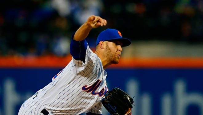 Apr 7, 2017; New York City, NY, USA;  New York Mets starting pitcher Zack Wheeler (45) delivers a pitch against the Miami Marlins in the first inning at Citi Field. Mandatory Credit: Noah K. Murray-USA TODAY Sports