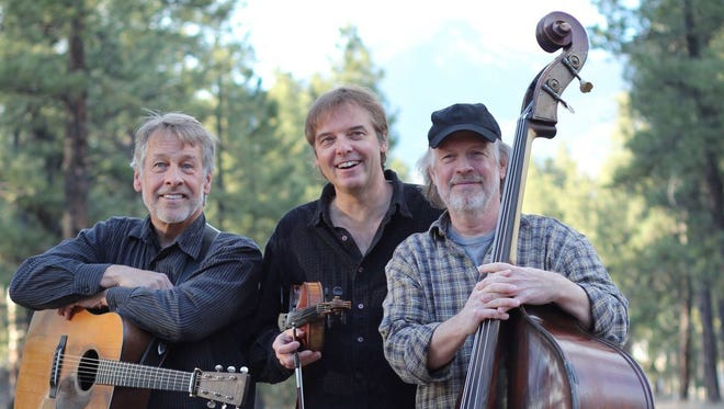 Fiddler Chris Brashear, center, will join The Sonoran Dogs for the Roots Revival concert on Sept. 10 at the OC Tanner Amphitheater in Springdale.