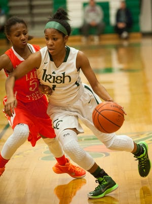 Camden Catholic's Taiah Thornton drives the ball past Woodrow Wilson's Ciarah Bennett. Thornton had a game-high 23 points in her team's Olympic Conference victory Tuesday night. The Irish outscored the Tigers 40-15 after the break.