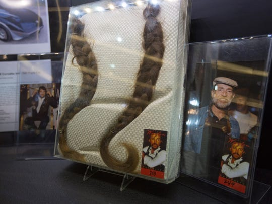 One of the most coveted items, braids of Willie Nelson's hair, sit behind glass during the auction.