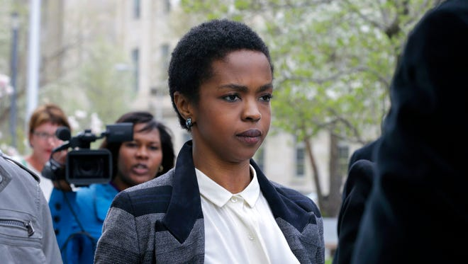 Lauryn Hill leaves federal court in Newark, N.J. Hill's attorney says she has been released from federal prison after serving time for failing to pay taxes.