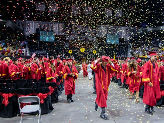 Confetti rains down from the sky as the graduates leave the Pan American Center floor at the 2017 Centennial High School Commencement on May 20, 2017.