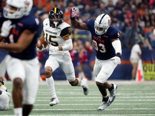 Oct 7, 2017; San Antonio, TX, USA; Southern Mississippi Golden Eagles wide receiver Allenzae Staggers (15)  is chased by San Antonio Roadrunners defensive end Marcus Davenport (93) during the first half at Alamodome. Mandatory Credit: Soobum Im-USA TODAY Sports