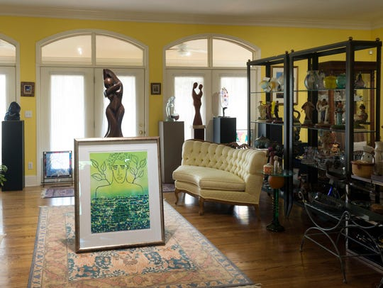 Art-filled shelves separate the living room into two