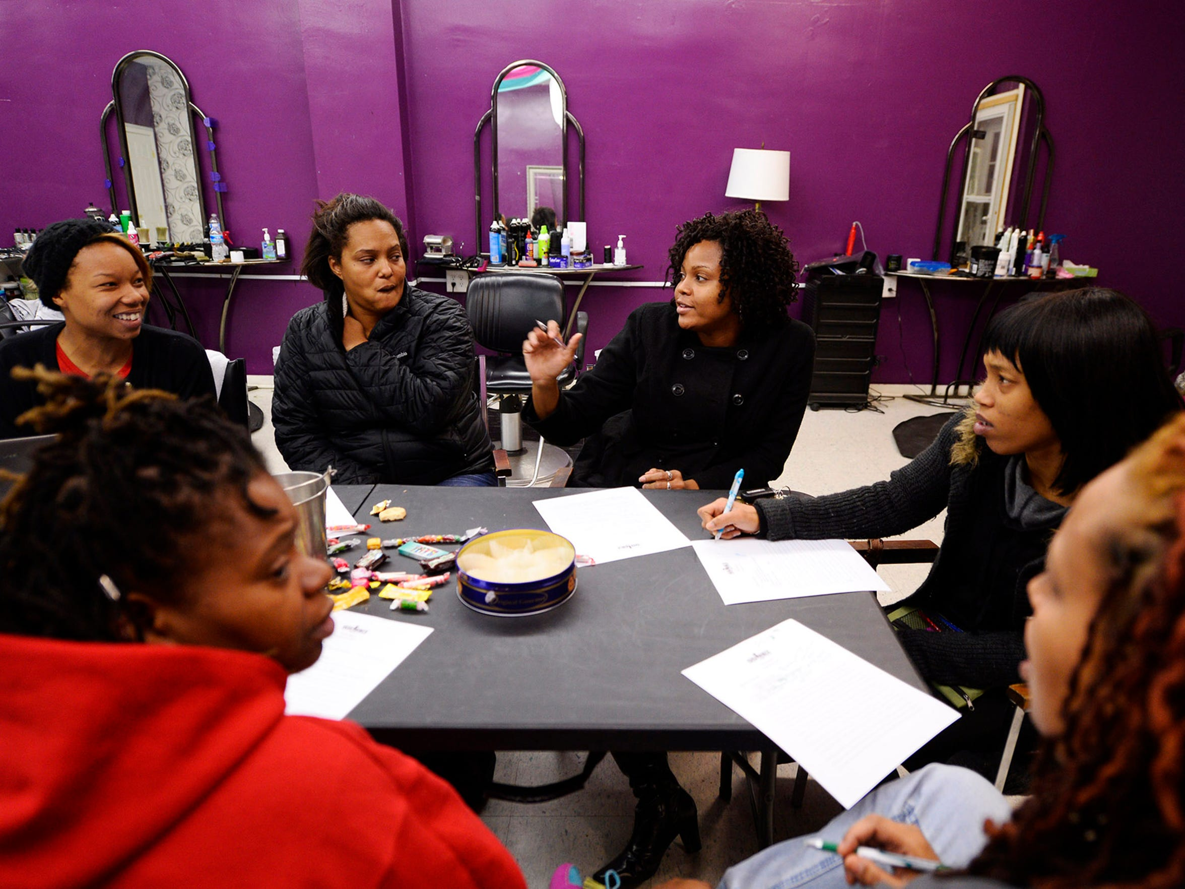 "YAYA leaders, clockwise form bottom left: Norma Johnson, Alisha Shockley, Chivonne ShockleyMoore, Dericka Scales, Keisha Jenkins, and Marisa Wilson plan for upcoming weeks at Beneath the Surface, a salon owned by Wilson, in York in November. ""We decided to start this group to show and teach girls how to become better friends, mothers, sisters and women in this community,"" said Wilson, a founding member and president of YAYA Girls. ""We try to focus on things that empower the girls and make them better women as they grow up."""