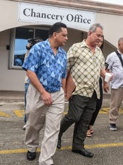 Accuser Roland Sondia, center, prepares to depart from the Archdiocese of Agana chancery office in Hagatna with his attorney, David Lujan, on Thursday, Feb. 16, 2017. Both men met with Vatican tribunal members in regards to the allegations of child sexual abuse by Archbishop Anthony Apuron in the 1970s.