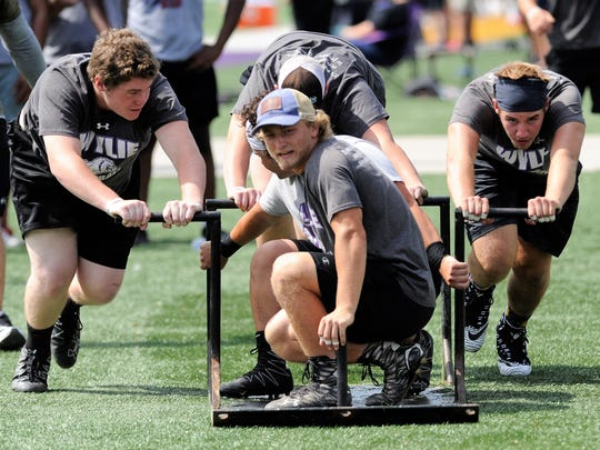 The Wylie team competes in the Monster Sled during the State LineMAN Challenge at Hardin-Simmons University's Shelton Stadium on Saturday. The Bulldogs finished sixth in the Division II competition.