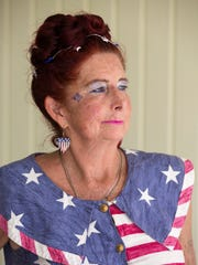 Mary Demere, 58, poses for a portrait in the flag dress she wears every year for the Independence Day celebration on Saturday, July 1, 2017 in Everglades City. The celebration featured a parade followed by food, face painting, arts and crafts vendors, raffles, kiddiesÕ best dressed contest, and playground games.