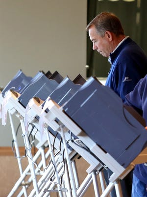 Speaker John Boehner casts his vote at VOA Park in West Chester on Election Day, Nov. 4, 2014.