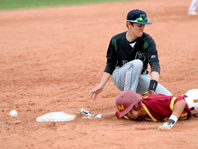 Fossil Ridge's Trevor Butters misses a catch while trying to get Rocky Mountain's Dean Lawson out at third during their game Saturday, April 12, 2014, at Rocky Mountain. Lawson was able to score on the play adding to Rocky's 9-1 win.