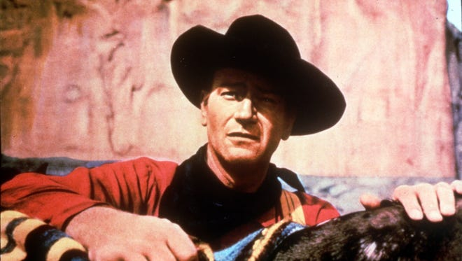 "John Wayne in a scene from the 1956 movie ""The Searchers."""