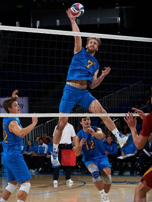 UCLA's Mitch Stahl blasts a kill against Southern Cal at Pauley Pavilion during a match Jan. 20, 2017.
