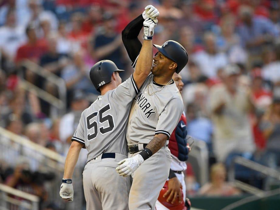 New York Yankees' Aaron Hicks, right, celebrates his