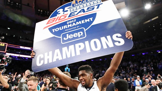 Villanova's Kris Jenkins  celebrates after the Wildcats defeated Creighton in the finals of the Big East men's tournament on March 11 in New York. Villanova won 74-60.