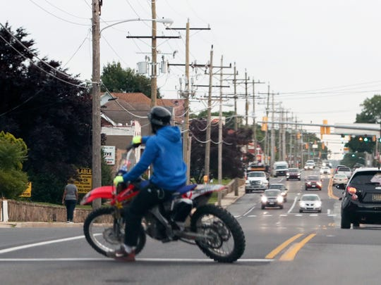 An unregistered dirt bike rider turns around on Maryland Avenue near Elsmere after riding from Wilmington Tuesday, June 12, 2018.