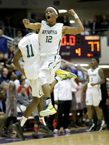 Crispus Attucks Tigers Zac Owens (12) celebrates with