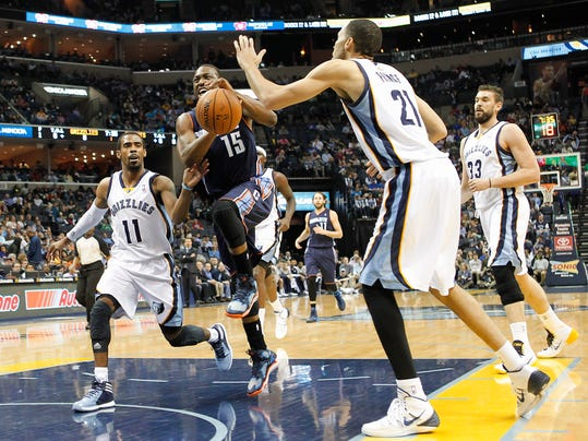 Charlotte Bobcats guard Kemba Walker (15) drives to the basket against Memphis Grizzlies defenders Mike Conley (11), Tayshaun Prince (21) and Marc Gasol (33), of Spain, in the first half of an NBA basketball game Saturday, March 8, 2014, in Memphis, Tenn. (AP Photo/Lance Murphey)