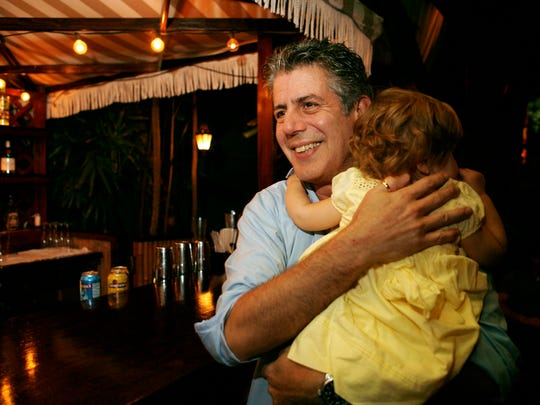 Anthony Bourdain holds his daughter Ariane in Miami