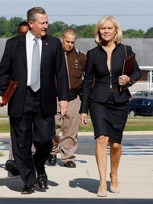 Alabama speaker Mike Hubbard with wife Susan Hubbard walks to the Lee County Justice Center on Tuesday, May 24, 2016 in Opelika, Ala. The speaker of Alabama's House of Representatives is going on trial on felony charges that could result in his removal from office.