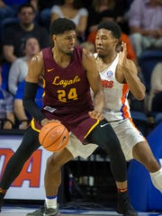 Loyola of Chicago forward Aundre Jackson (24) posts up against Florida guard KeVaughn Allen (5) during the second half of an NCAA college basketball game in Gainesville, Fla., Wednesday, Dec. 6, 2017. Loyola of Chicago won 65-59. (AP Photo/Ron Irby)