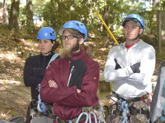 Maria Cabanas, Rusty Archenbach and Mike Waldron listen to instructions on the rope course at the North Carolina Outward Bound School in Linville.