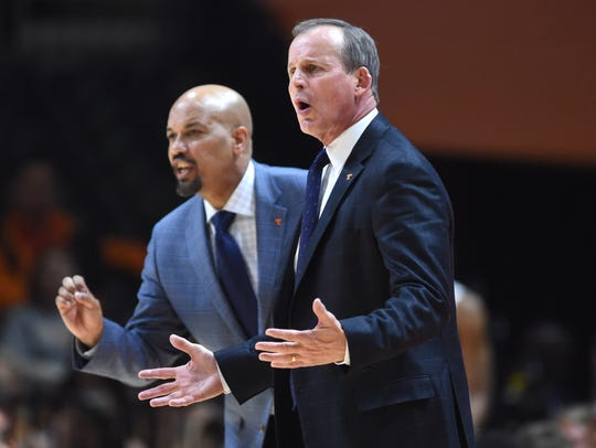 Tennessee associate head coach Rob Lanier, left, has had three stints with coach Rick Barnes.