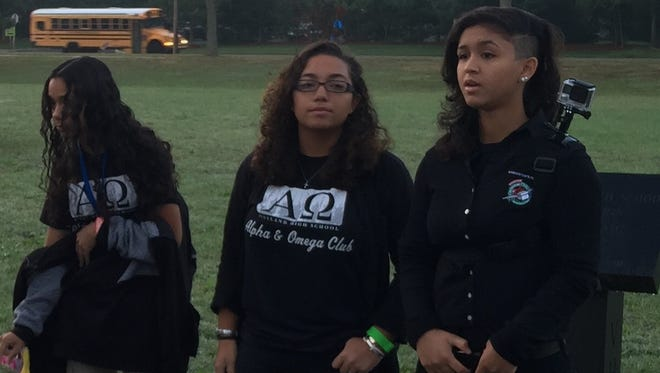 (From left) Kyari Quinones, Emily Morton, Stacy Sanchez-Ortiz participated in See You at the Pole Day at Vineland High School. Sanchez-Ortiz, president of Alpha & Omega, led the prayers for those who had gathered at the VHS flagpole.