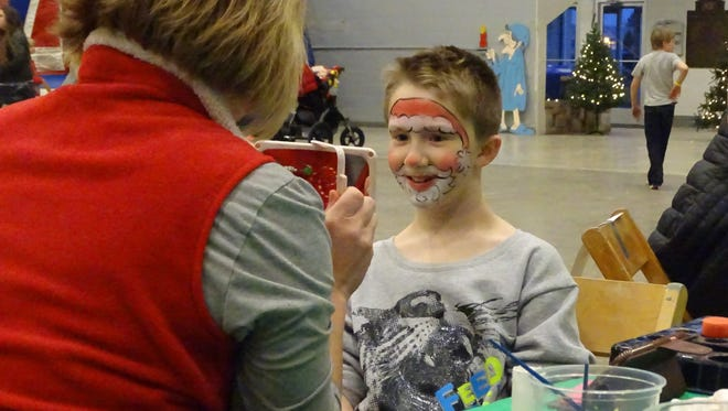 Dalton Shockey, 9, got his face painted Saturday at the Veterans Memorial Coliseum at the Marion County Fairgrounds, where kids could pet goats, play ring toss, play bowling with oversized pins and take pictures with Santa Claus and Mrs. Claus.