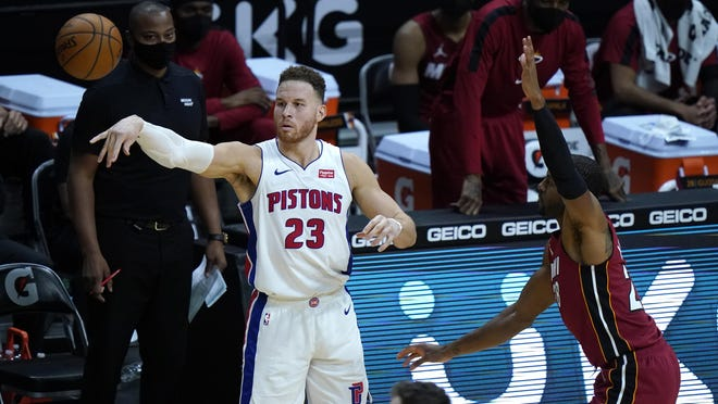 Detroit Pistons forward Blake Griffin (23) passes as Miami Heat forward Andre Iguodala defends during the second half of an NBA basketball game, Saturday, Jan. 16, 2021, in Miami.