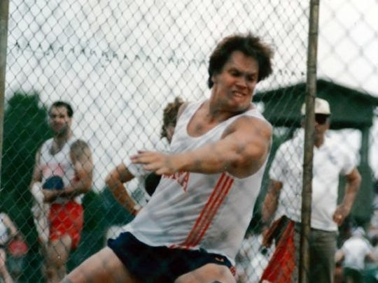 Former Middletown North standout Pat Toland shown throwing the discus at the University of Virginia.